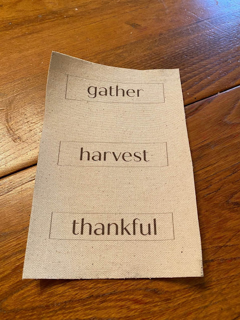 Photo of muslin labels with fall words.