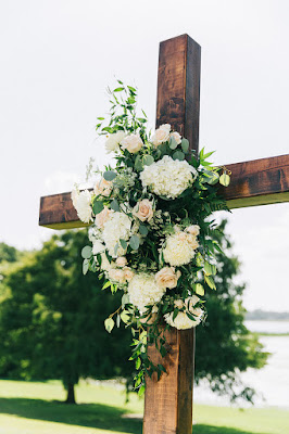 wooden cross and flowers