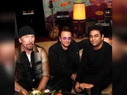 A R Rahman poses with Irish rock band U2 members Bono and The Edge