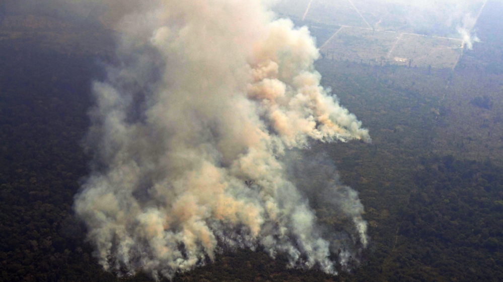 Aerial picture showing smoke from a two-kilometre-long stretch of fire billowing from the Amazon rainforest about 65 km from Porto Velho