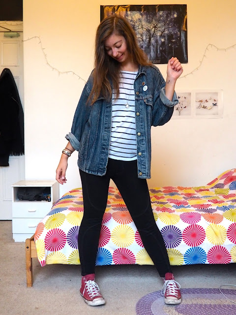 Vintage - outfit of second hand thrifted blue denim jean jacket, white striped top, black leggings & red Converse