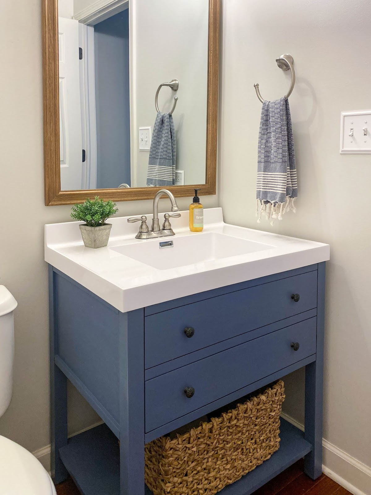 blue powder room vanity