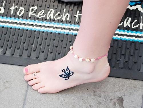 Tatuagem de borboleta no Pé