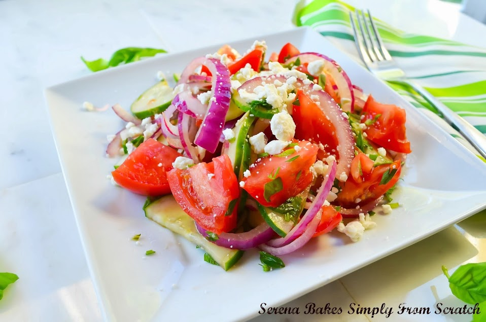 Tomato Cucumber Herb Salad with Balsamic Vinaigrette on a white plate.