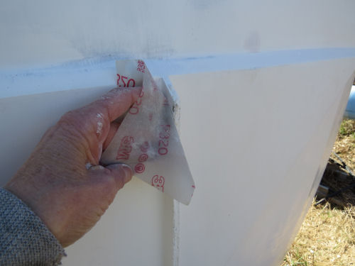 sanding between paint coats on a  fiberglass trailer