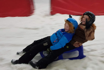 Snow Play Chill Factore review two boys on double sledge grinning