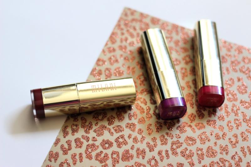 Milani lipsticks on a white table