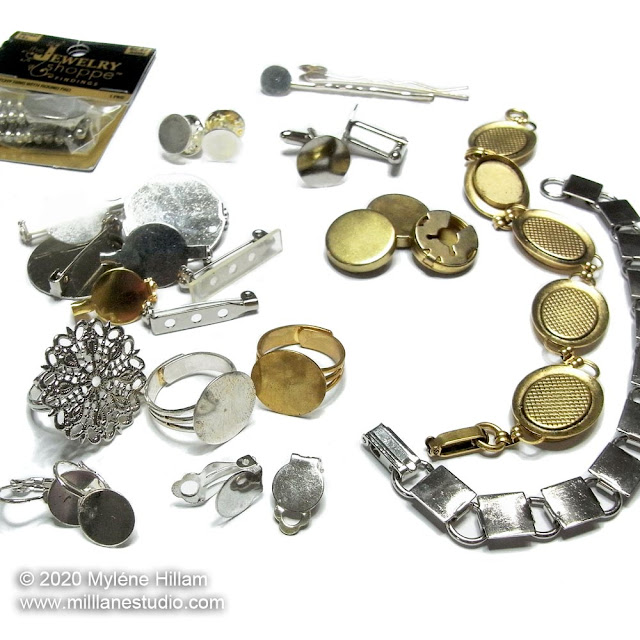 Selection of gold and silver flat pad jewellery findings, including, earrings, rings, brooches, button covers, bracelets and hair clips
