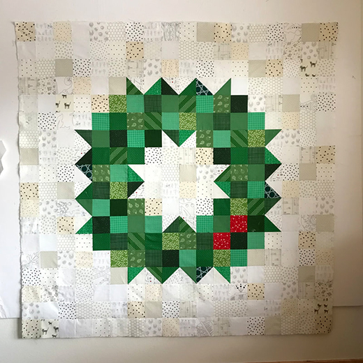 Patchwork Wreath Mega Block Quilt Free Tutorial designed by Myrth McDonald of Handmade Myrth