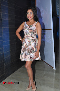 Actress Madhu Shalini Stills in Floral Short Dress at RGV Shiva to Vangaveeti Event  0201.JPG