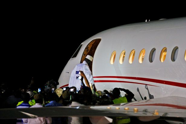 Former-Gambian-president-Yahya-Jammeh-boards-a-private-jet-before-departing-Banjul-into-exile