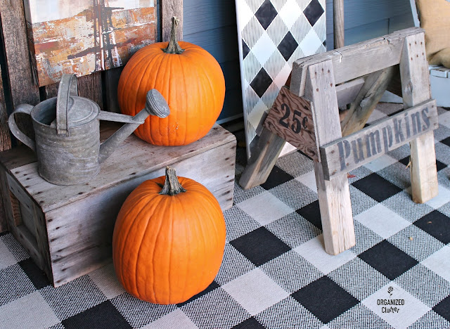 Photo of a rustic wooden sawhorse stenciled with PUMPKINS 25 cents.