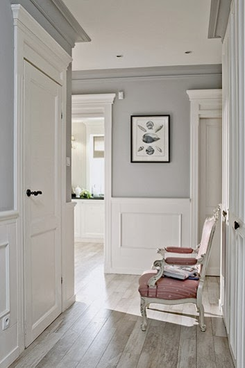 white wainscoting gray walls, gray crown molding, oak floor, pink chair