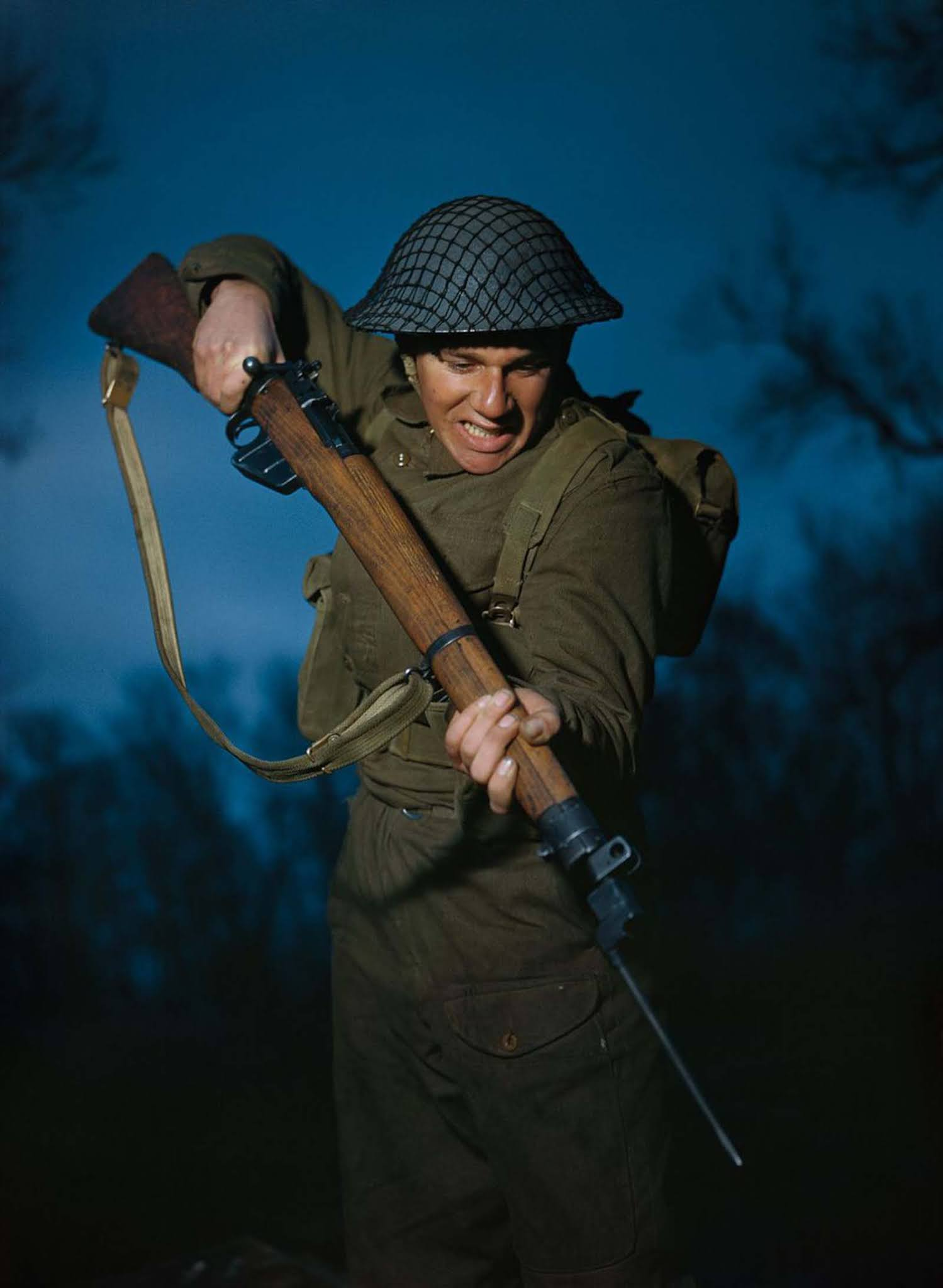 Private Alfred Campin of the 6th Battalion, Durham Light Infantry during battle training in Britain. 1944.