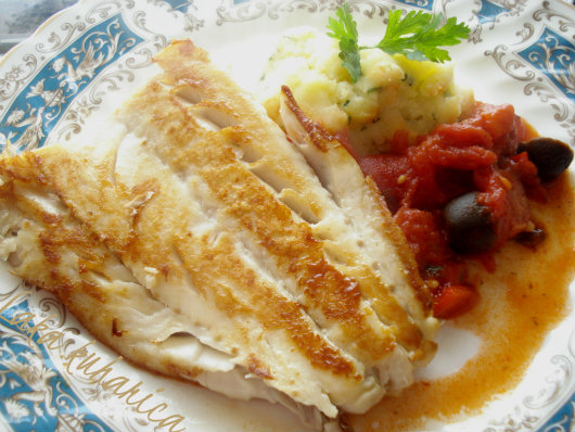 Cod with tomatoes, olives and chorizo by Laka kuharica: cod fillets become a gourmet meal topped with tangy sauce.