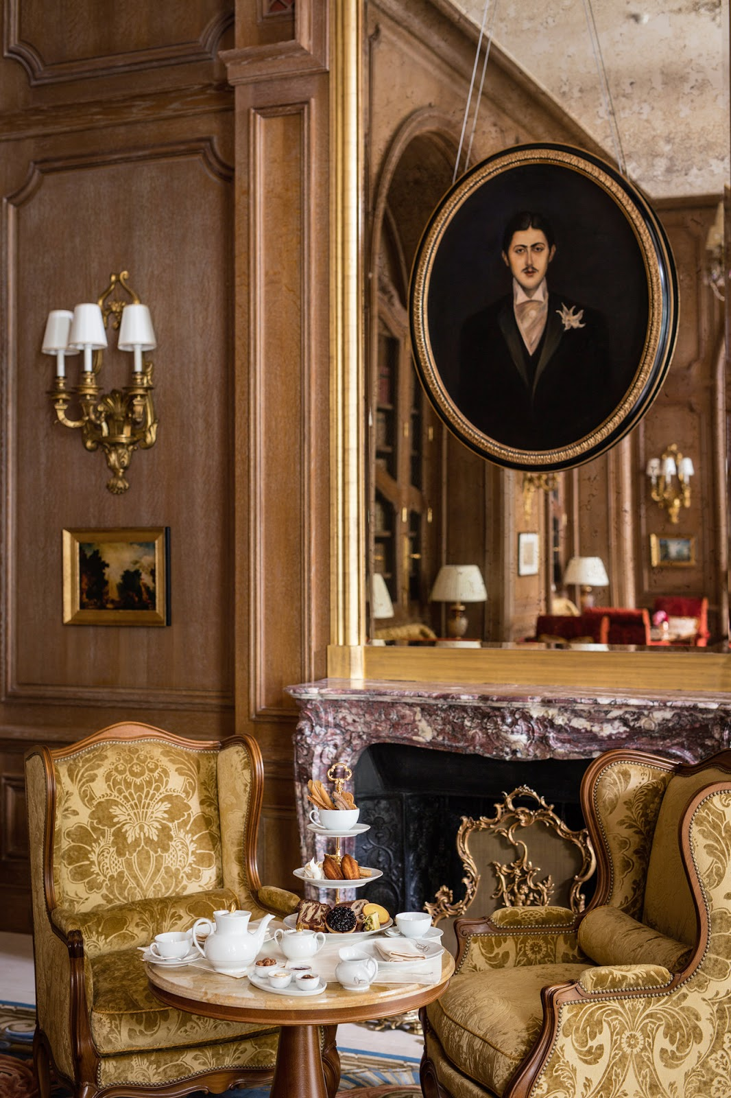 Masculine fireplace and suite at renovated Ritz Paris