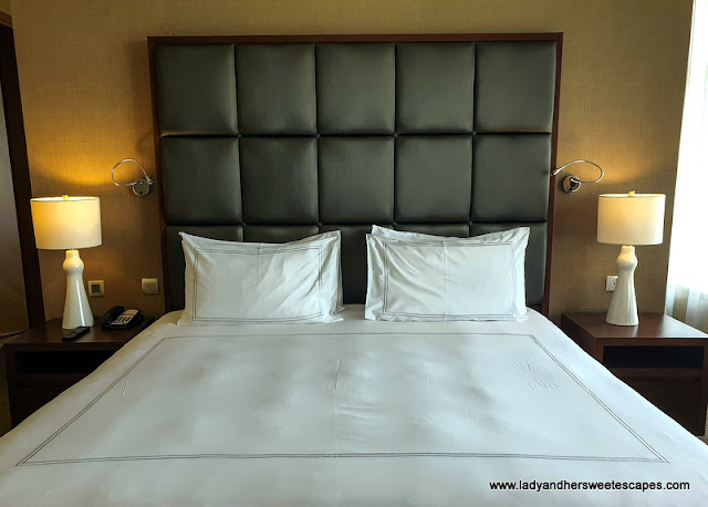 king size bed at Swissotel Al Ghurair Dubai