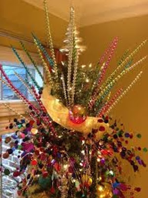 decorar la punta del arbol con ramas deoradas
