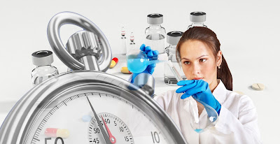 Picture of a woman chemist mixing vials behind a stop-watch