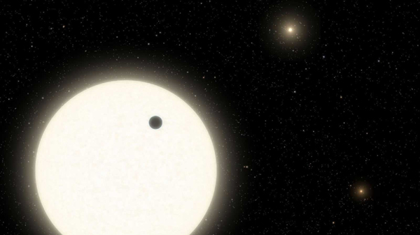 An artist's concept of the exoplanet KOI-5Ab orbiting its parent star in the KOI-5 system.