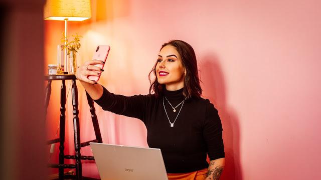 An Influencer taking a selfie