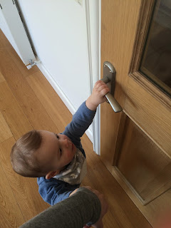 toddler baby opening door