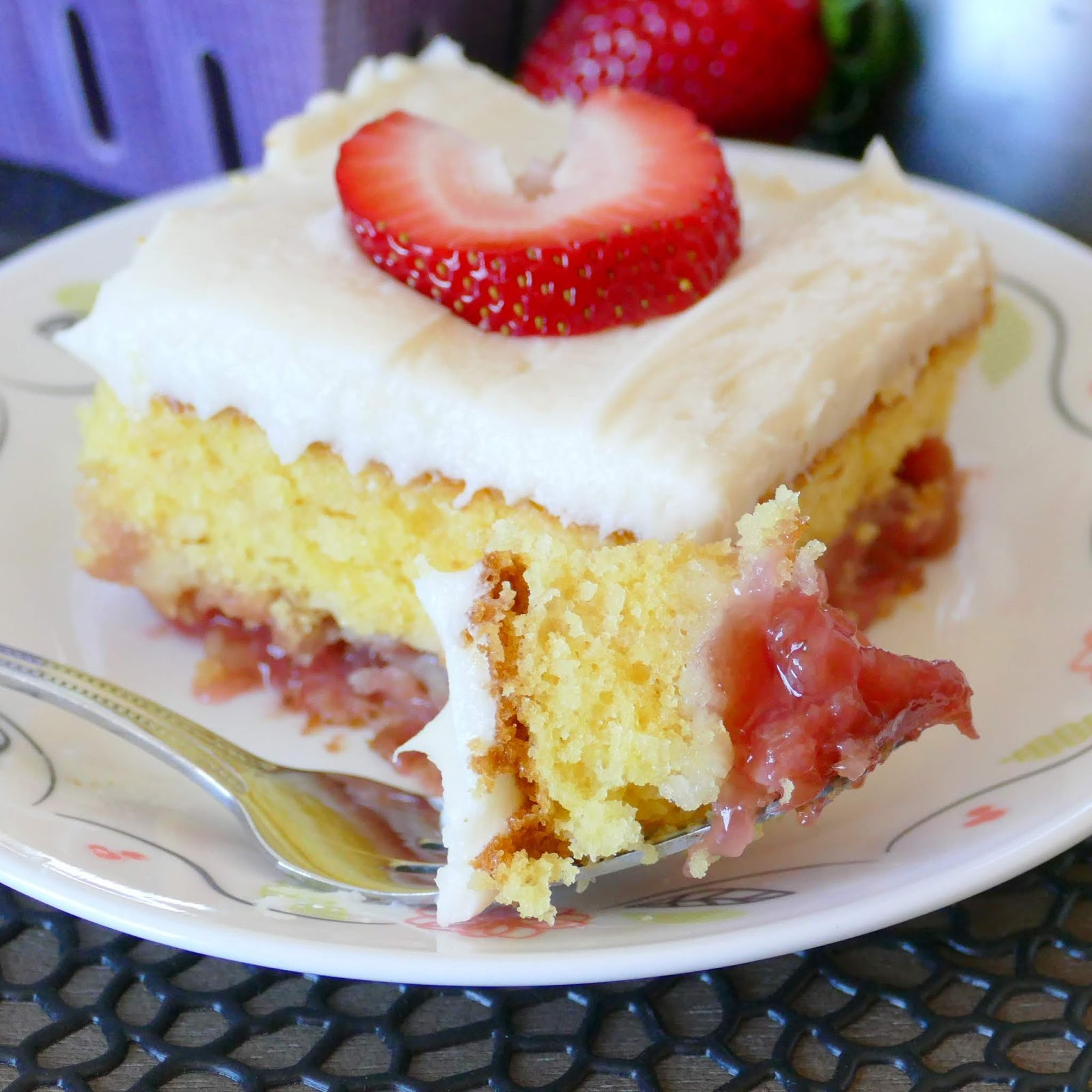 This spring and summer dessert is wonderful for any occasion. The rhubarb and strawberry layer is delicious with the cake and homemade buttercream frosting! Use fresh or frozen rhubarb!