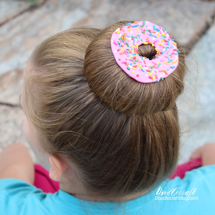 hair clip made of hot glue to look like a donut on a sock bun