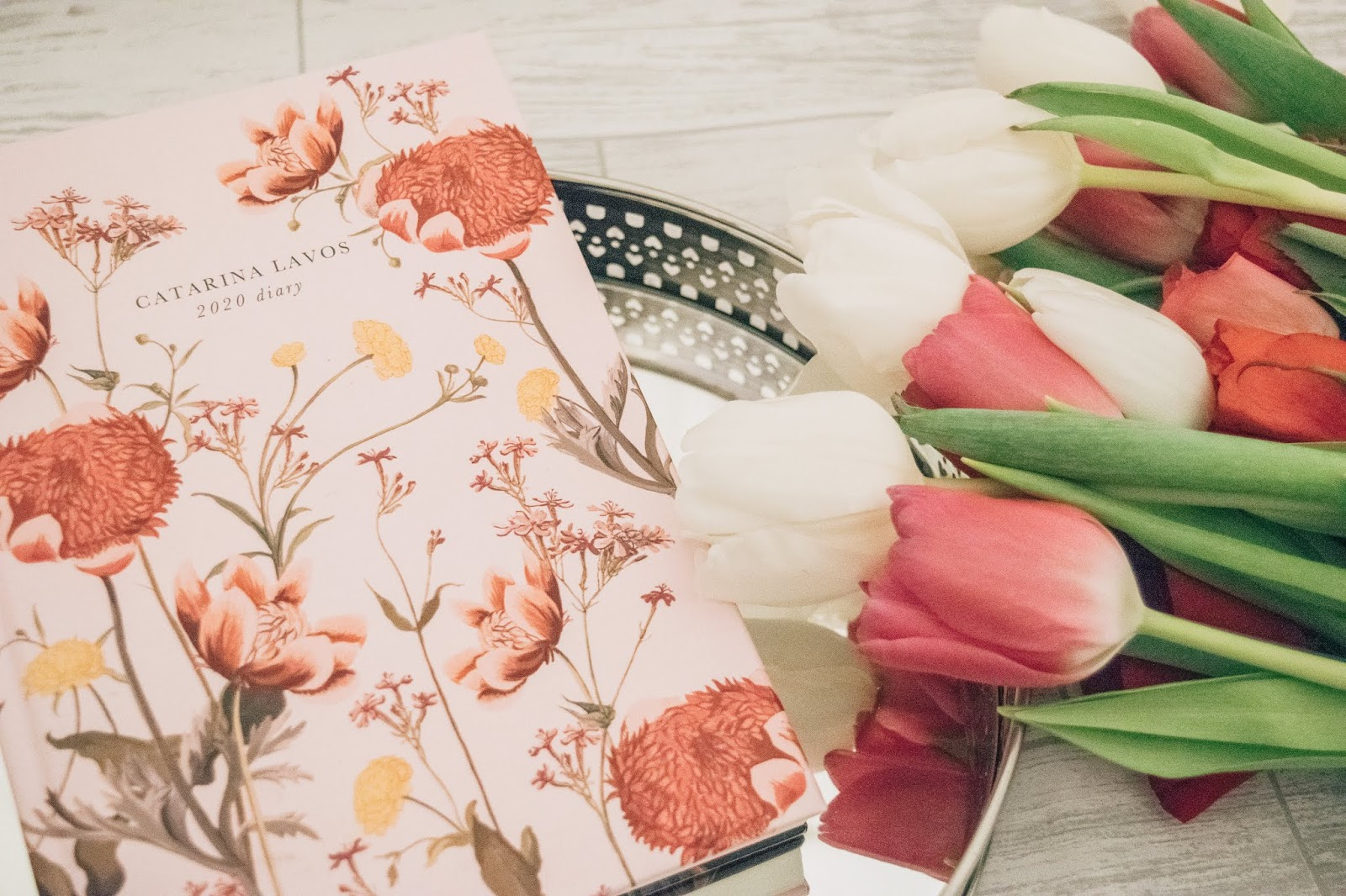 Pink floral 2020 diary with a bunch of flowers.