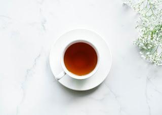white cup tea