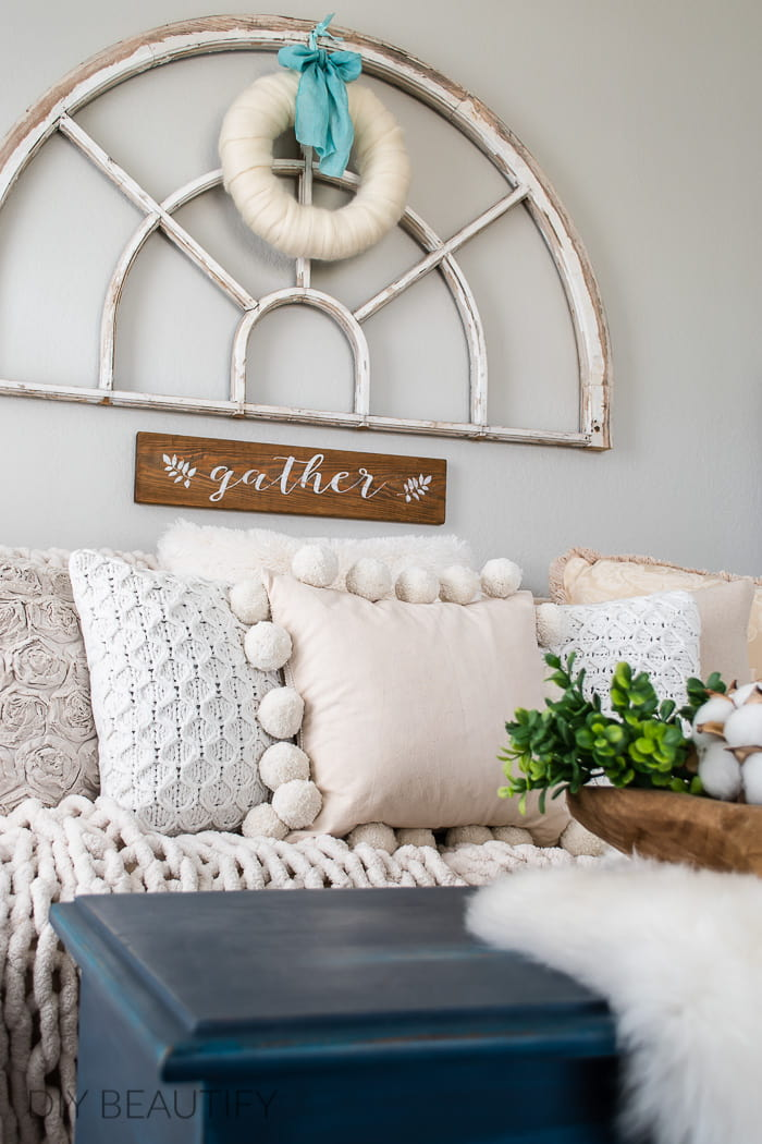 neutral pillows and natural wool wreath
