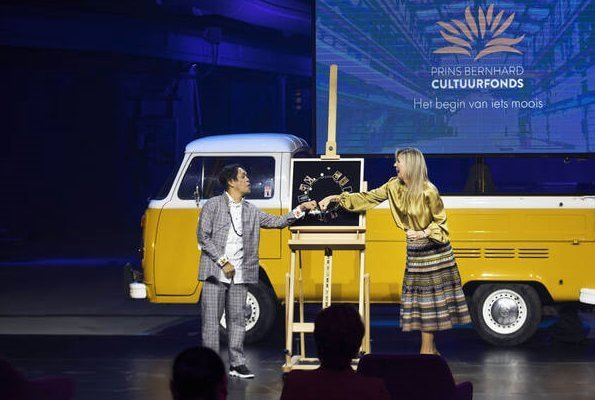 Bernhard Culture Fund Prize 2020. Queen Maxima wore a yellow satin balloon sleeve rounded neckline blouse, and paisley printed midi skirt
