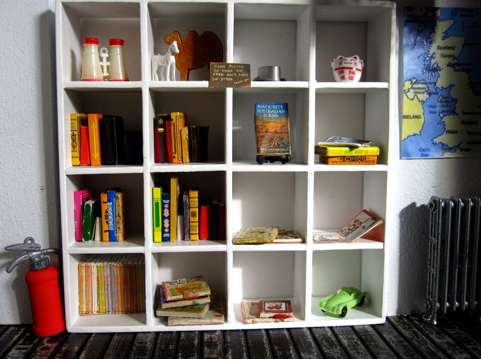 Bookcase in a modern dolls' house miniature pop-up Little Library,