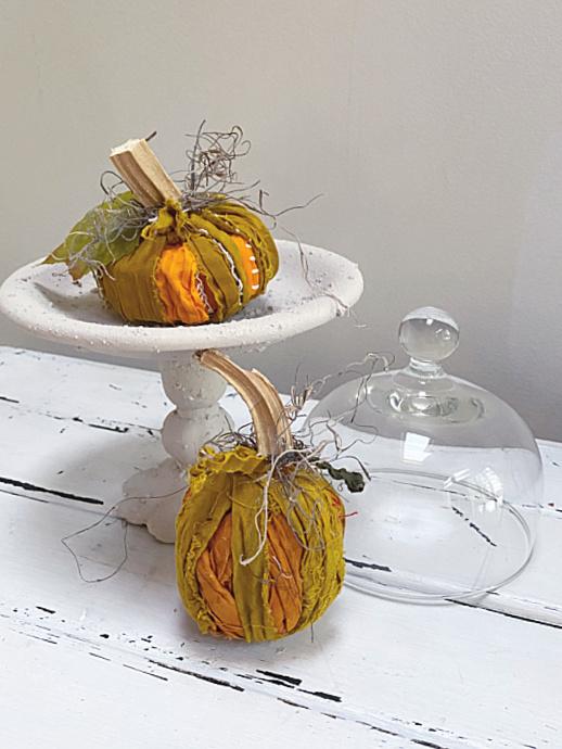 rag pumpkins on a pedestal dish