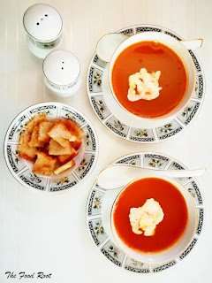 Tomato soup cooked in a pressure cooker. Add veggies in the cooker, boil it and then strain off the liquid. Blend the solid contents and return it to pan. Add strain water, fresh water and cook it for 30 minutes. Season it with salt and pepper. Stir in some cream until you reach the desire texture.