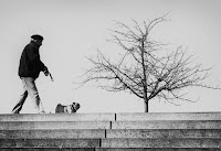 Man with pug - black and white street photography Berlin