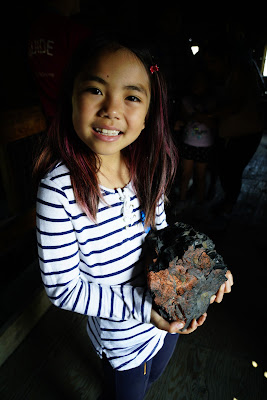 Miya holds a big lump of Wildfire coal.