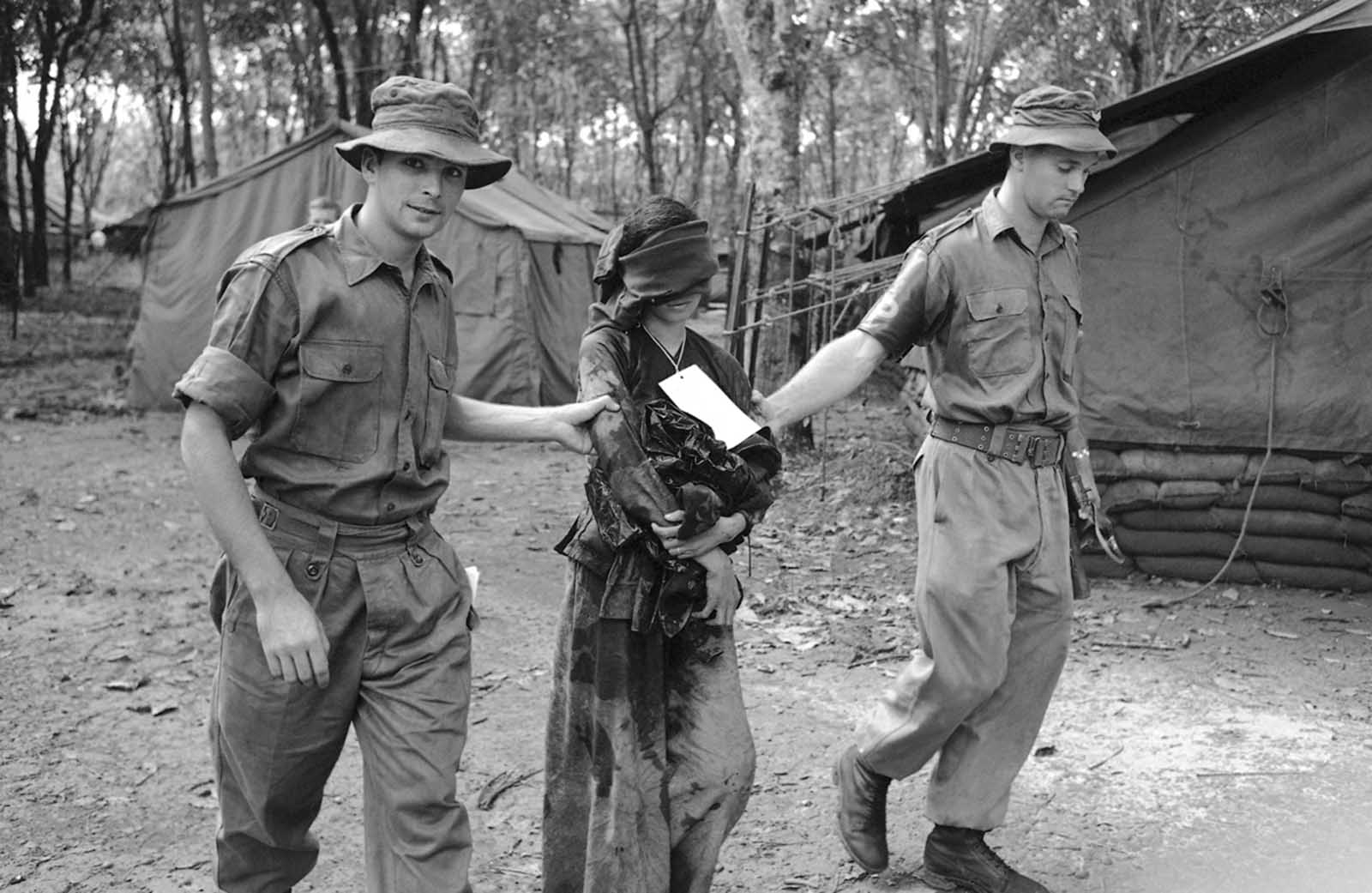 A Vietnamese girl, 23 years old, was captured by an Australian patrol 30 feet below ground at the end of a maze of tunnels some 10 miles west of the headquarters of the Australian task force (40 miles southeast of Saigon). The woman was crouched over a World War II radio set. About seven male Viet Cong took off when the Australians appeared—but the woman remained and appeared to be trying to conceal the radio set. She was taken back to the Australian headquarters where she told under sharp interrogation (which included a