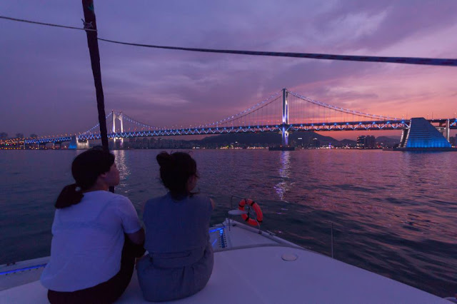 Enjoying Busan night view on a yacht