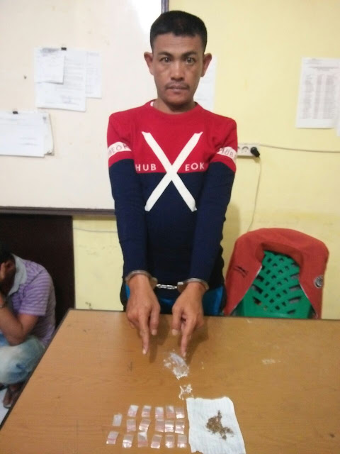BS tersangka narkoba yang kabur dari tahan Polres Taput dan ditangkap saat bersembunyi di pondok di kebun jeruk.