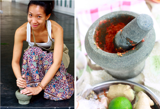 pounding spices with mortar and pestle for curry paste