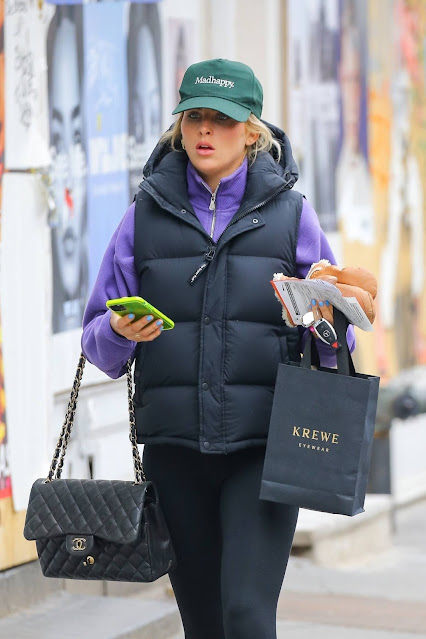 Paige Lorenze – wearing a MadHappy green hat and a CHANEL bag in New York
