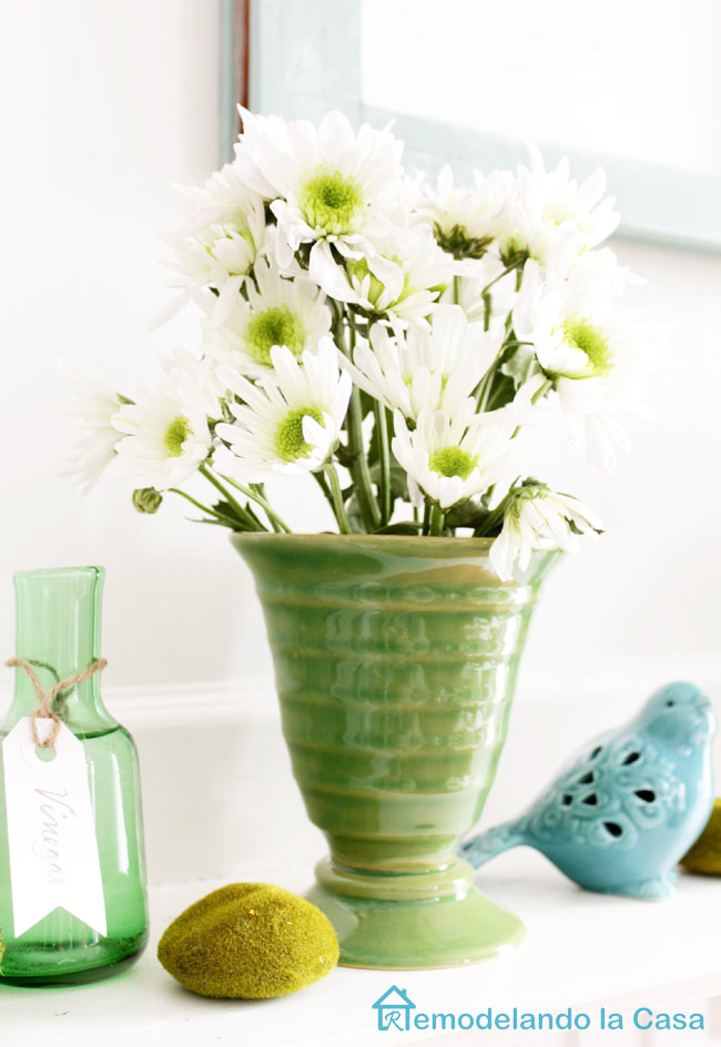 white flowers in green vase - Spring mantel with blue bird
