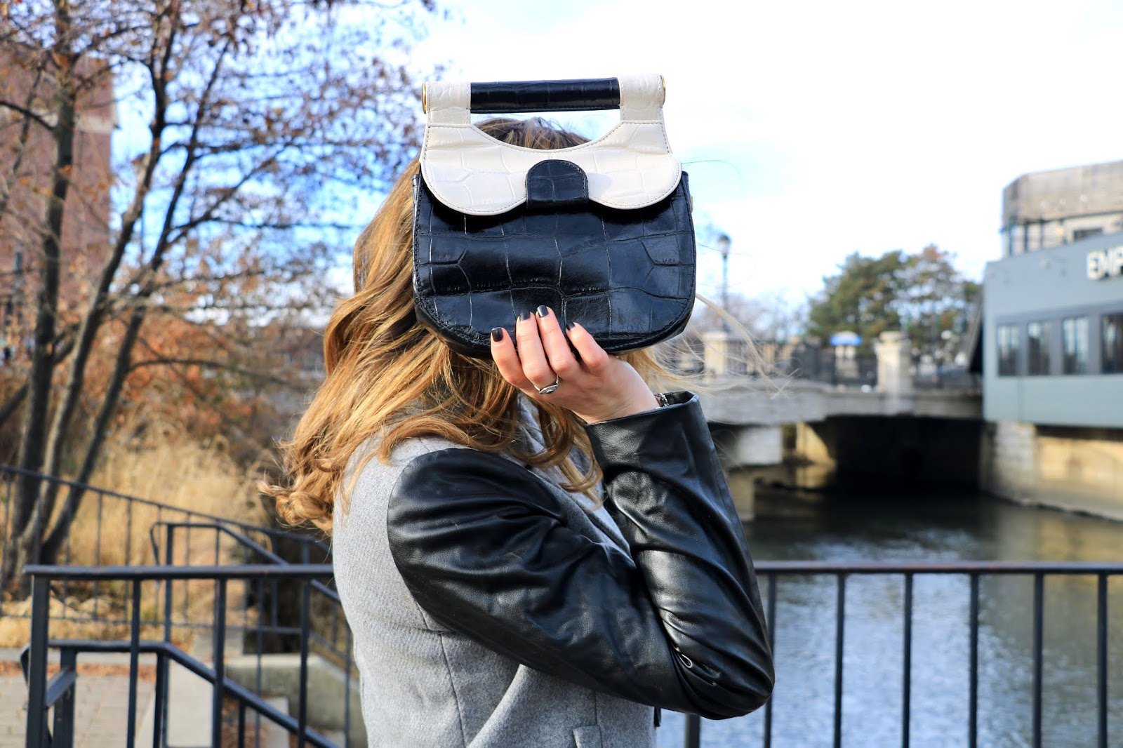 Nyc fashion blogger Kathleen Harper wearing a Staud black and white croc leather purse.