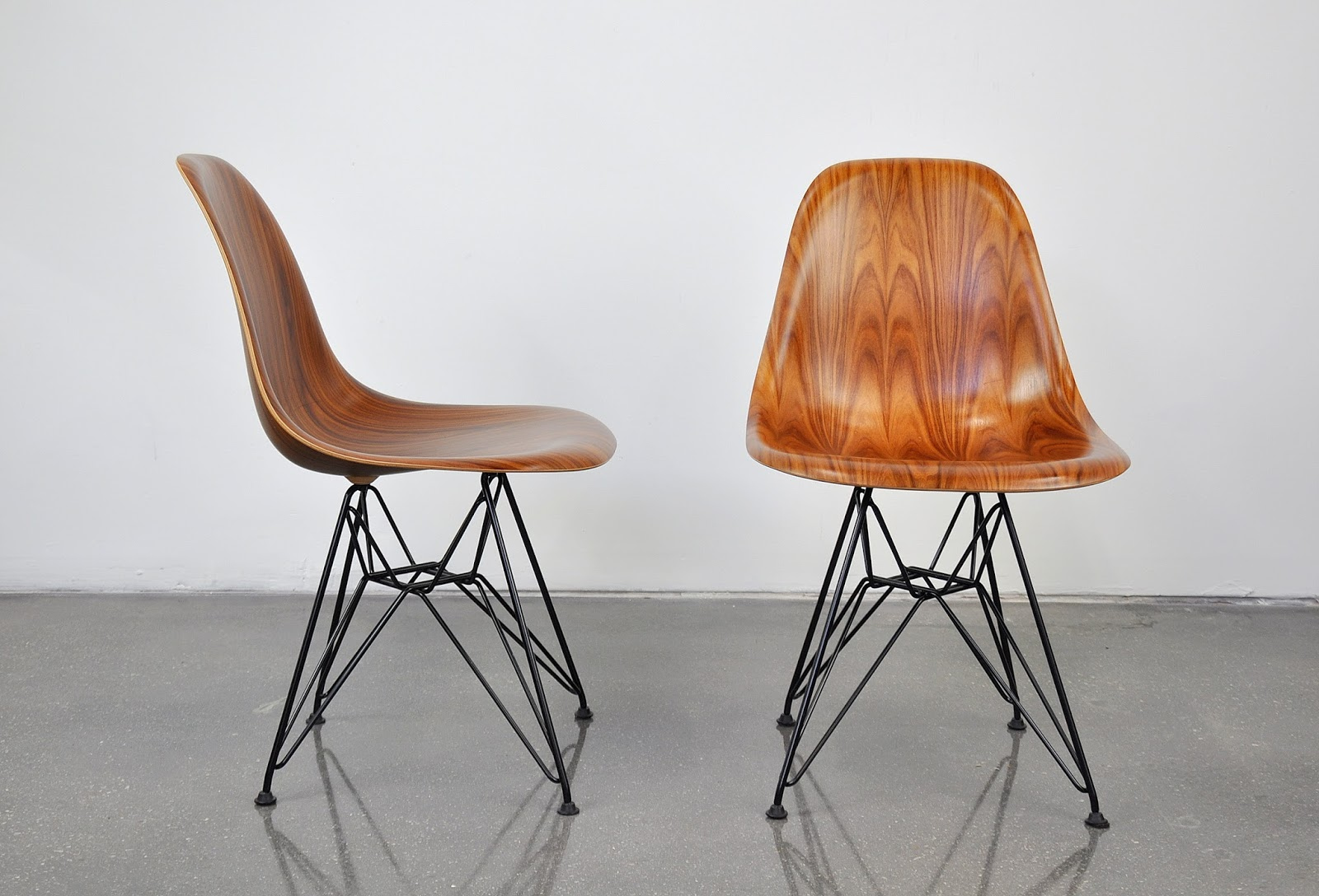 select modern pair of eames herman miller palisander and