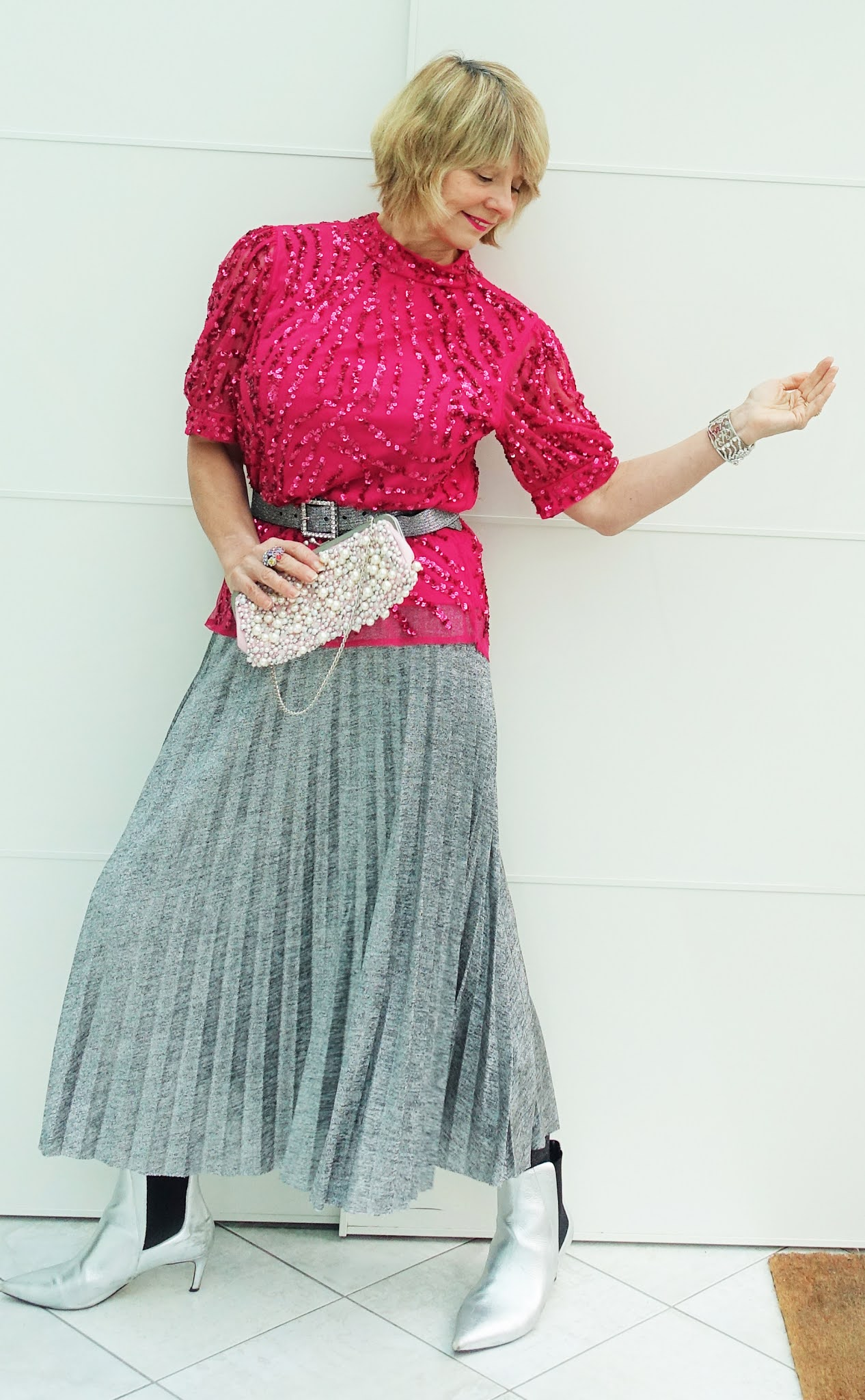Sequins for Christmas with style blogger Is This Mutton in pink Gemma top from Monsoon and silver pleated skirt