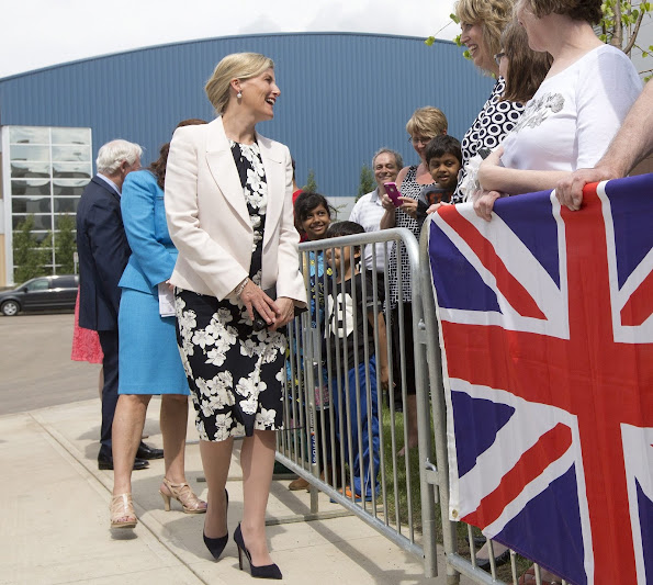 The Countess of Wessex in Edmonton, Canada. Sophie wore Erdem Analena Dress, Prada Suede pumps, Sophie Habsburg clutch, UFO pearl earrings and bracelet.