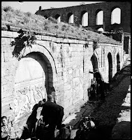 The Kırkçeşme spring and the Aqueduct of Valens (Bozdoğan Kemeri), April 1935. Men and children are fetching water from the Ottoman fountain that is decorated with Byzantine bas-reliefs [Credit: © Nicholas V. Artamonoff Collection, Image Collections and Fieldwork Archives, Dumbarton Oaks]