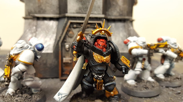 primaris space marine field police captain in gravis armour black veteran intercessors rogue trader