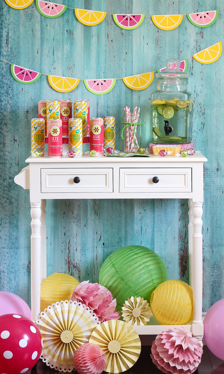 Watermelon and lemonade themed party decorations will add a fun pop of color to your summer drink station.